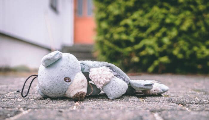 Bear plush toy lying on the road