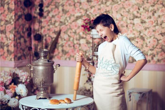 Woman screaming while making bread