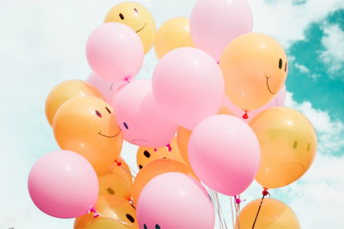 ow-angle photo of pink and orange balloons