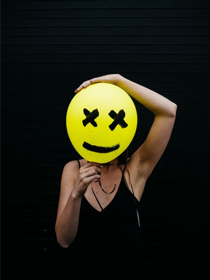 woman-holding-yellow-and-black-balloon-at-daytime